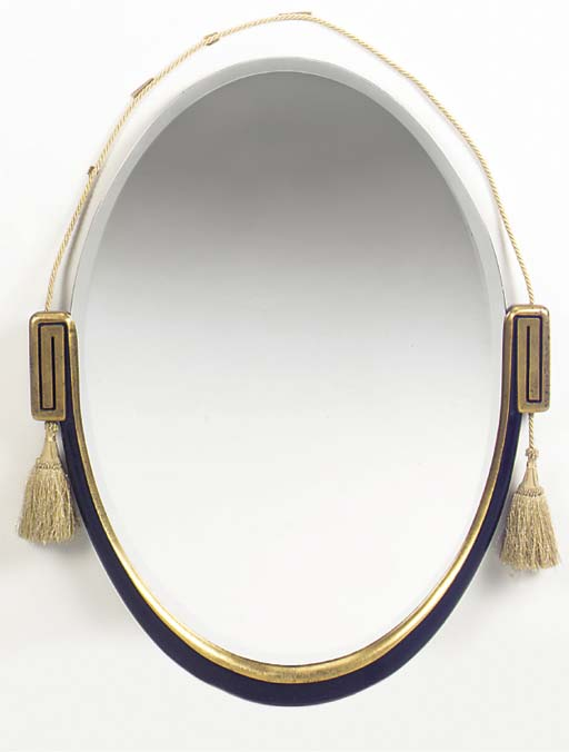 A GILTWOOD AND EBONISED MIRROR