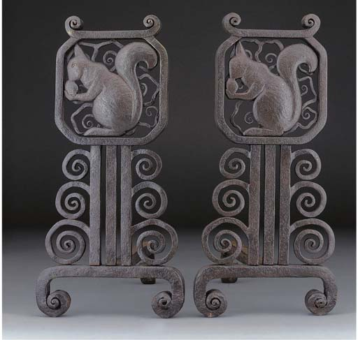 A pair of wrought iron firedog