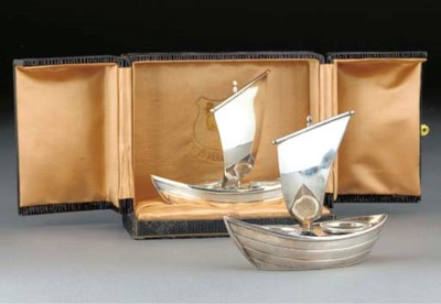A pair of silvered metal and g