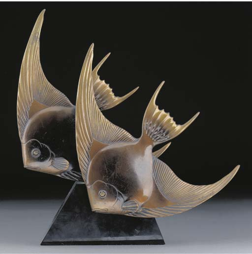 A patinated bronze figural gro