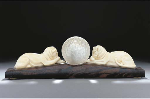 A carved ivory figural table l