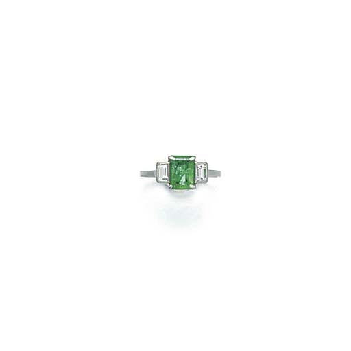 An emerald and diamond three s