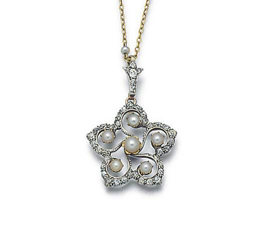 An antique diamond, half-pearl