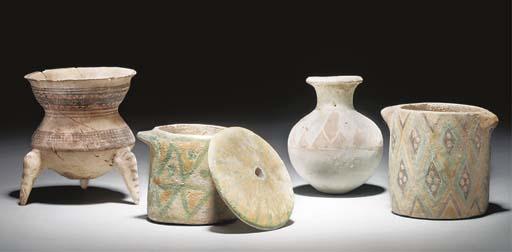 A NORTH-WEST PERSIAN POTTERY TRIPOD JAR