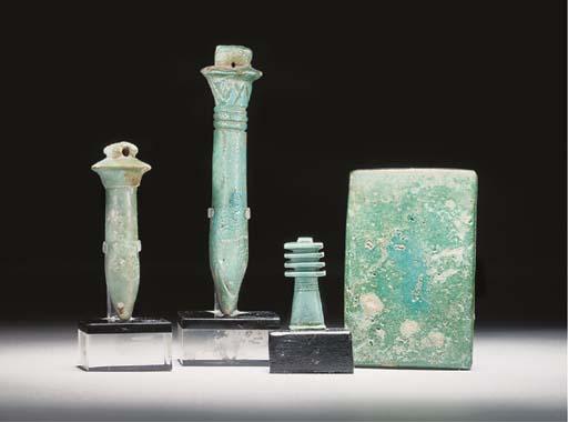 TWO EGYPTIAN TURQUOISE GLAZED COMPOSITION PAYPRUS STEM AMULETS