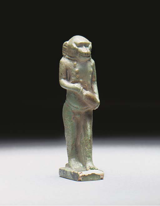 AN EGYPTIAN TURQUOISE GLAZED COMPOSITION BABOON AMULET