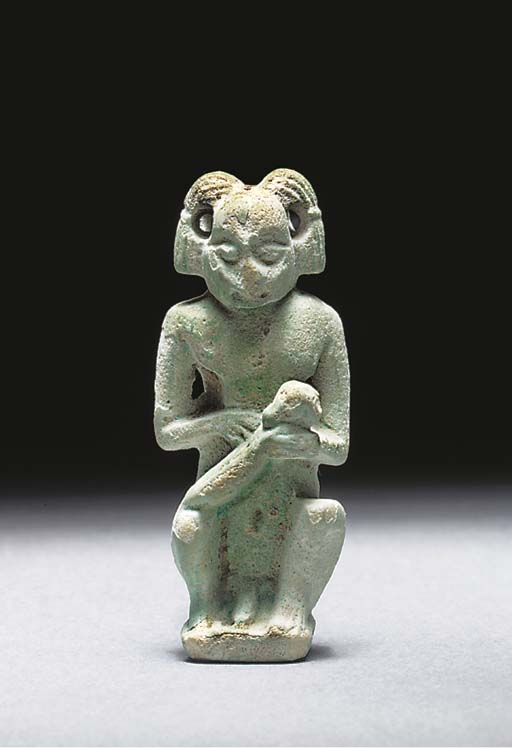AN EGYPTIAN PALE GREEN 'FRIT' STATUE OF A 'NUBIAN' MALE NURSE