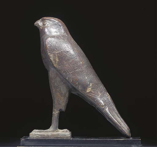 A LARGE EGYPTIAN BRONZE FIGURE OF HORUS THE FALCON