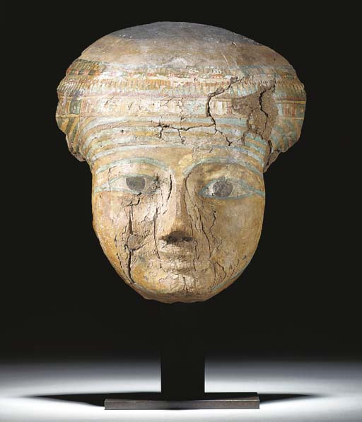 AN EGYPTIAN GESSO-PAINTED WOODEN ANTHROPOID MASK