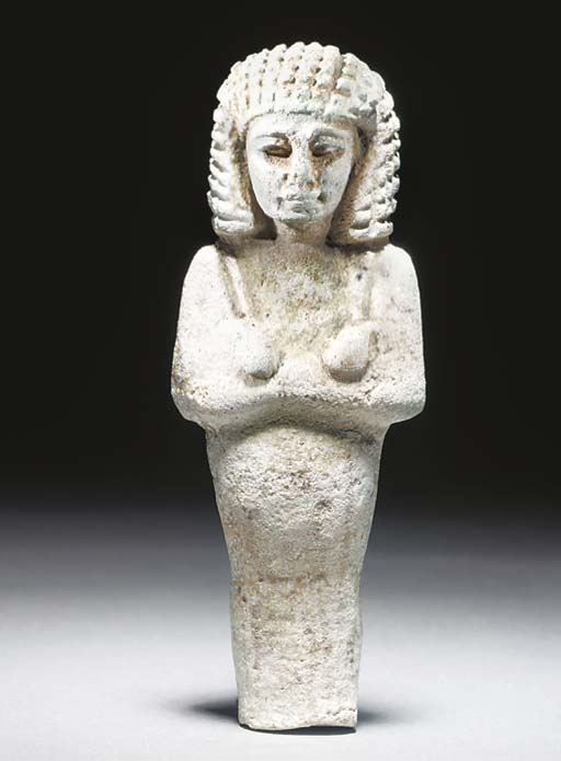 AN EGYPTIAN WHITEISH-GREEN GLAZED COMPOSITION SHABTI OF THE ELDER AND SERVANT OF KING TAKELOT II