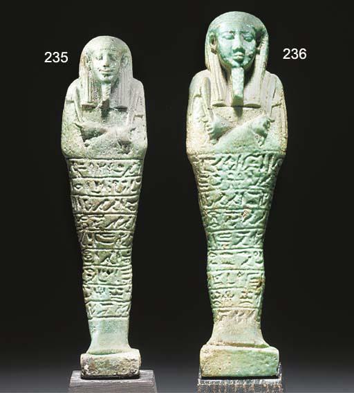 AN EGYPTIAN GREEN GLAZED COMPOSITION SHABTI OF KHA-EM-KHONSU, BORN OF TASHERI-IH