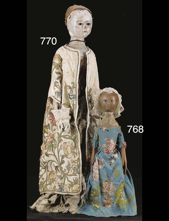 An English turned and carved wood doll
