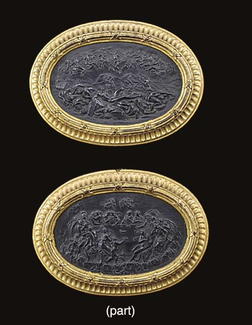 A pair of parcel gilt and bronzed terracotta oval panels depicting Classical scenes