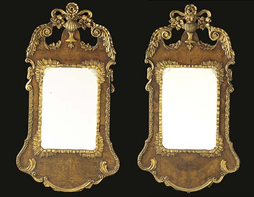A PAIR OF WALNUT AND PARCEL GILT MIRRORS