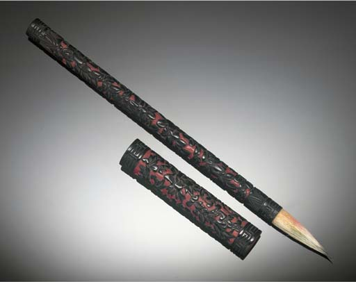 A carved black lacquer brush,