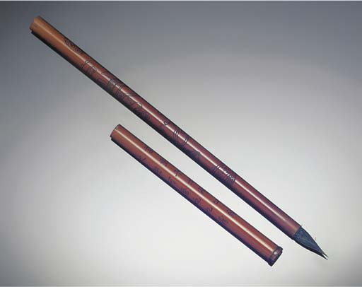 A slender bamboo brush and cov
