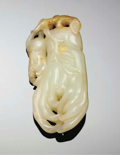 A celadon jade carving of a fi