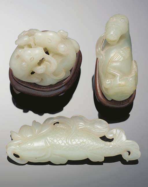 A celadon jade carving of a re