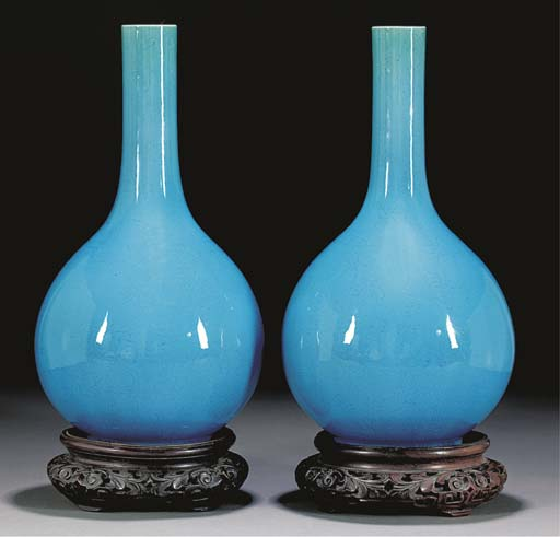 A pair of turquoise glazed bot