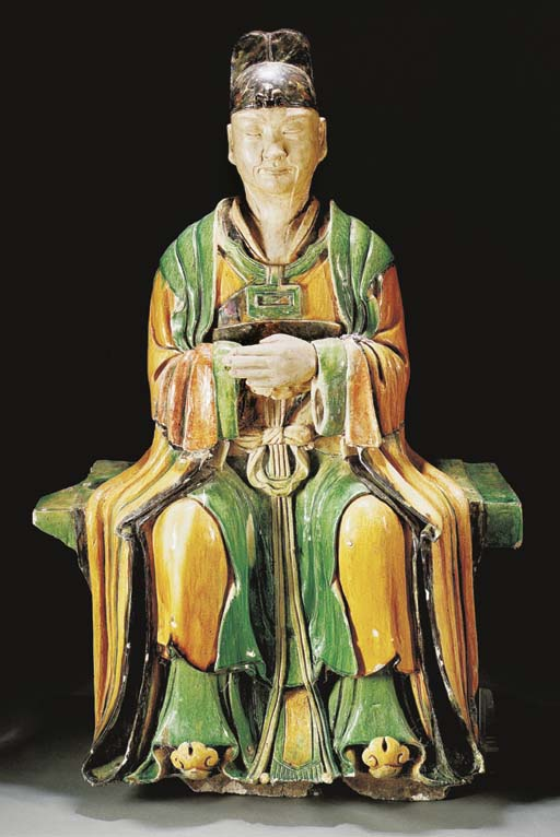 A massive Ming green, ochre and black glazed pottery model of a seated dignitary, dated 8th Month of the 8th year of Zhengde