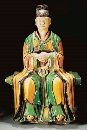 A massive Ming green, ochre and black glazed pottery model o