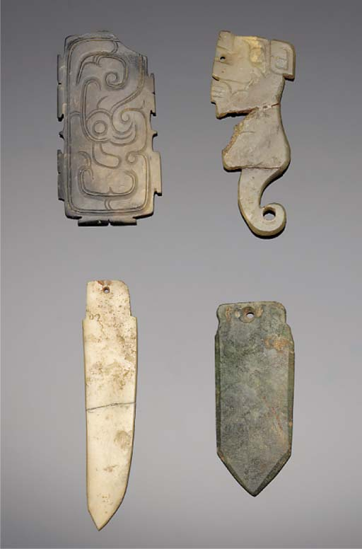 A group of jade pendants and a