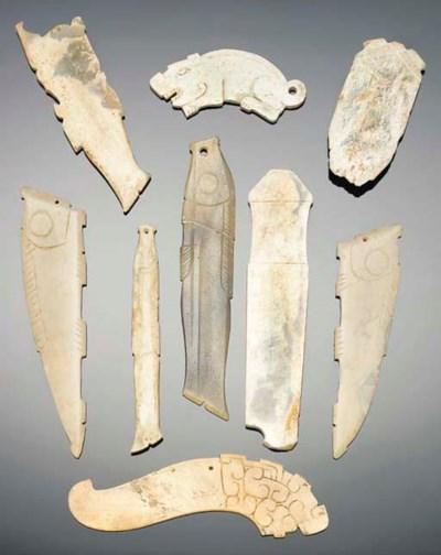 A group of nine jade pendants,