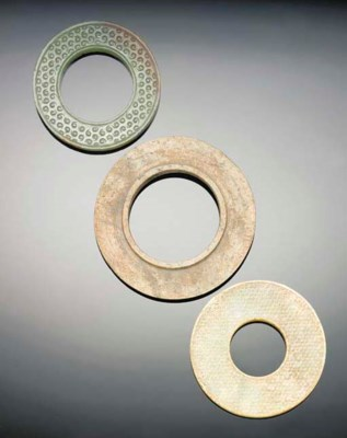 A group of three jade bi discs