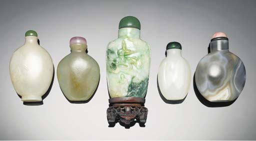 A carved jadeite snuff bottle,