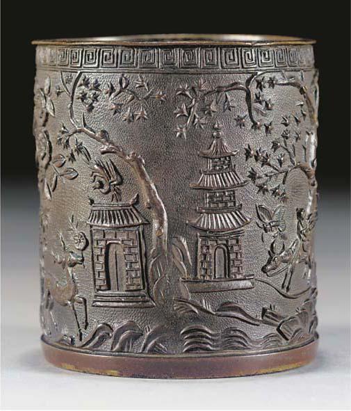 A cylindrical bronze brushpot,