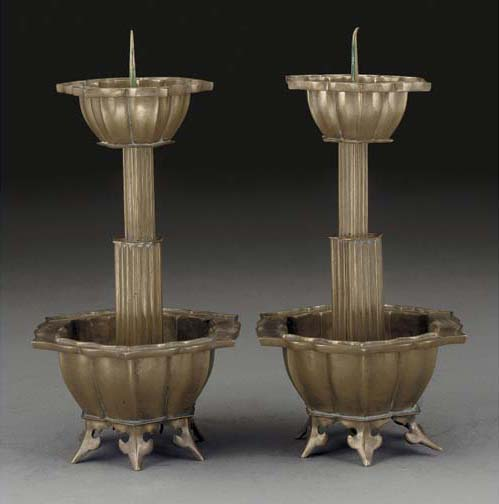 A pair of polished bronze pric