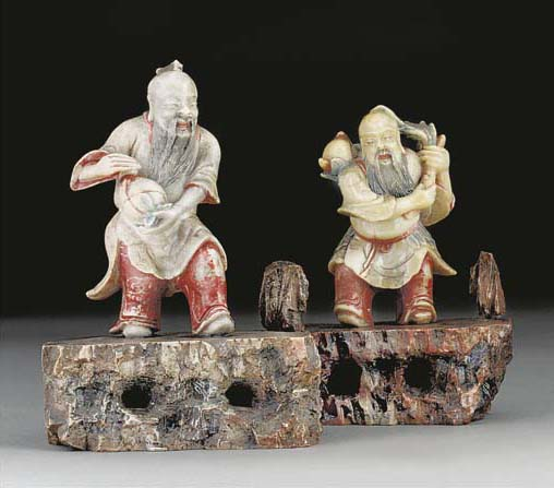 A pair of soapstone carved bea