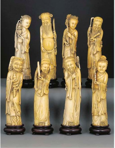 A set of eight stained ivory m
