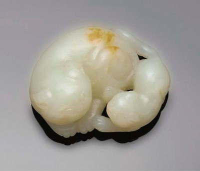 A pale celadon jade cat group,