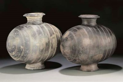 A pair of Han grey pottery coc