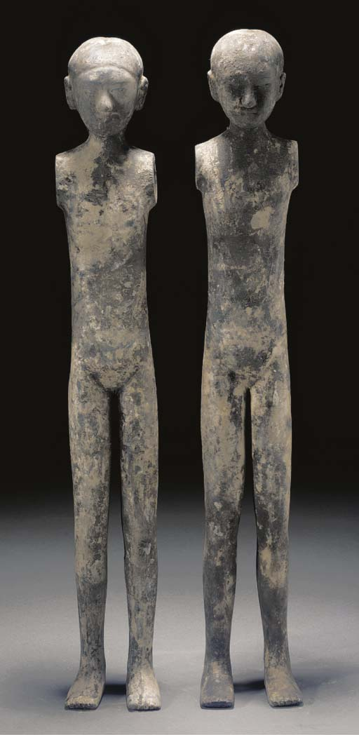 A pair of Han pottery stick fi