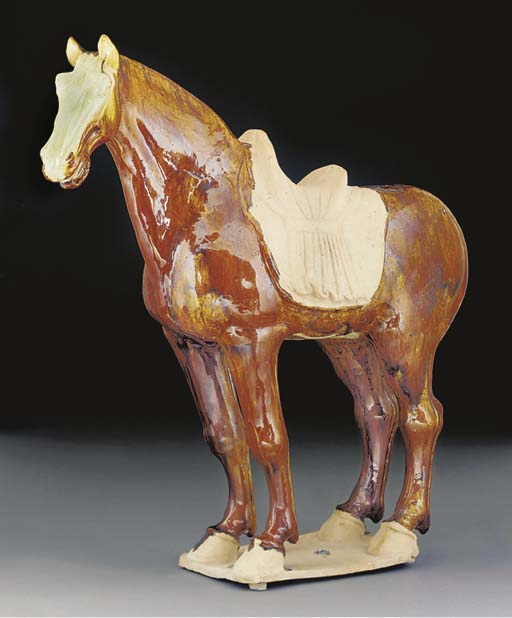 A large Tang painted pottery model of a horse