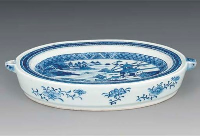 A blue and white oval warming