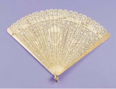 An ivory brise fan, with a cen