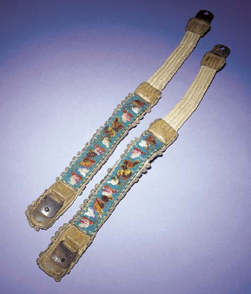 A pair of rare beaded sprung garters, worked with fuchsia and other flowers in brightly coloured beads against a vivid blue ground--13 x 1in. (33 x 2.5cm.), late 18th century