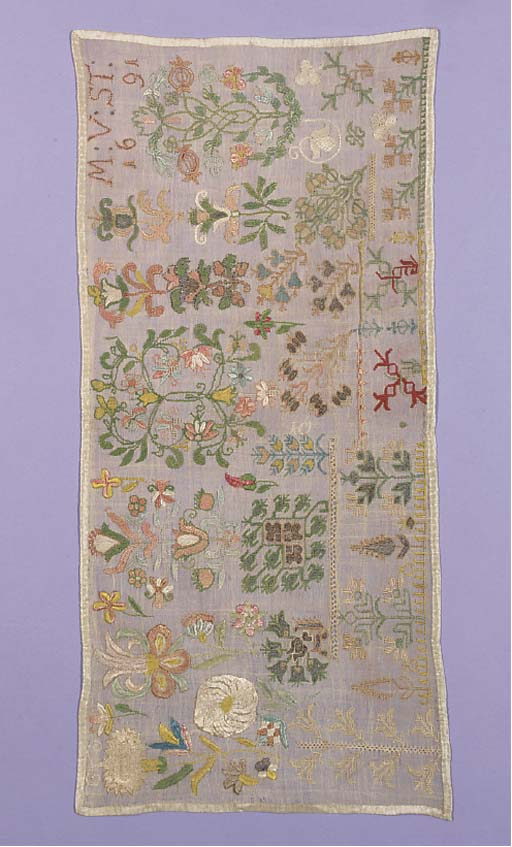 A sampler, worked with the initials M:V:ST, dated 1691, worked in coloured silks and metal thread on a fine linen ground, with spot motifs of repeated geometric patterns and stylised flowers--21½ x 10in. (55 x 26cm.)