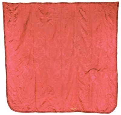 A shaped cover of crimson silk