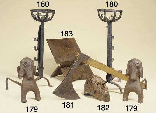 A PAIR OF CAST IRON ANDIRONS MODELLED AS DOGS