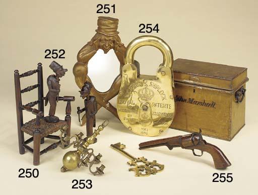 An oversized brass padlock and key