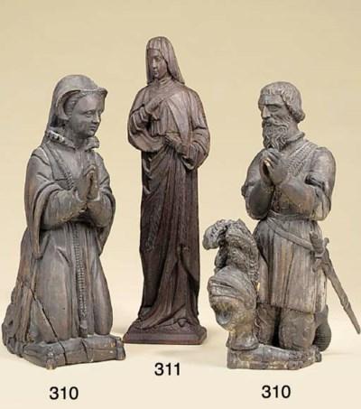 A pair of carved wood kneeling