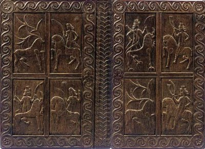 A SET OF EIGHT OAK PANELS