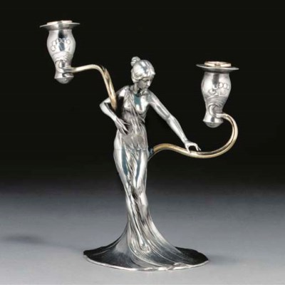 A WMF silvered metal figural c