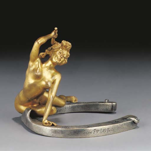 A gilt and silvered bronze fig