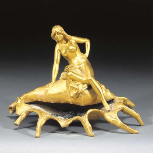 An Art Nouveau gilt and cold-painted spelter figural dish