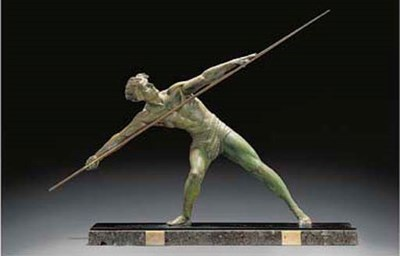 A green patinated spelter and